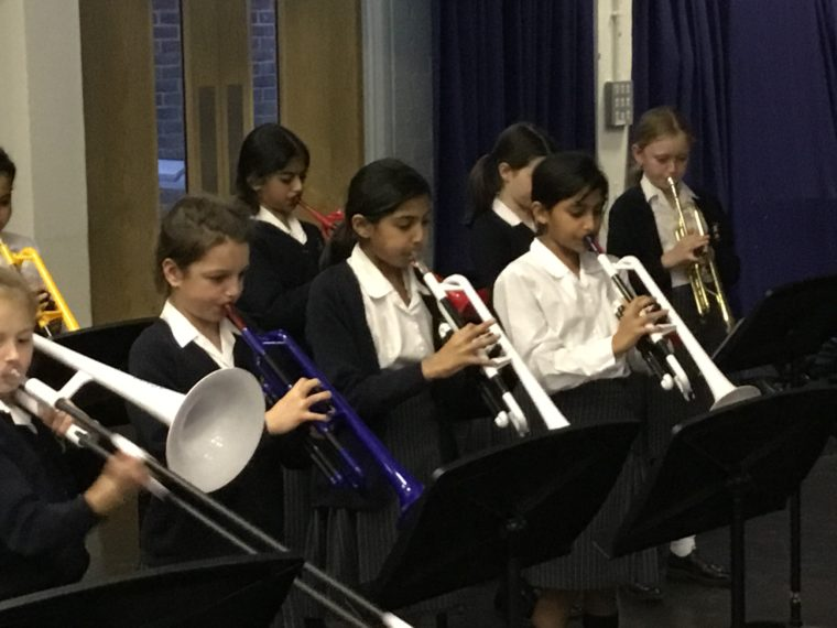 Juniors performing wind instruments in the concert.
