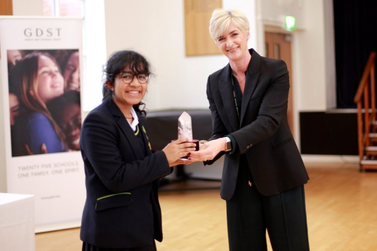Sarena receiving her award for winning the competition.